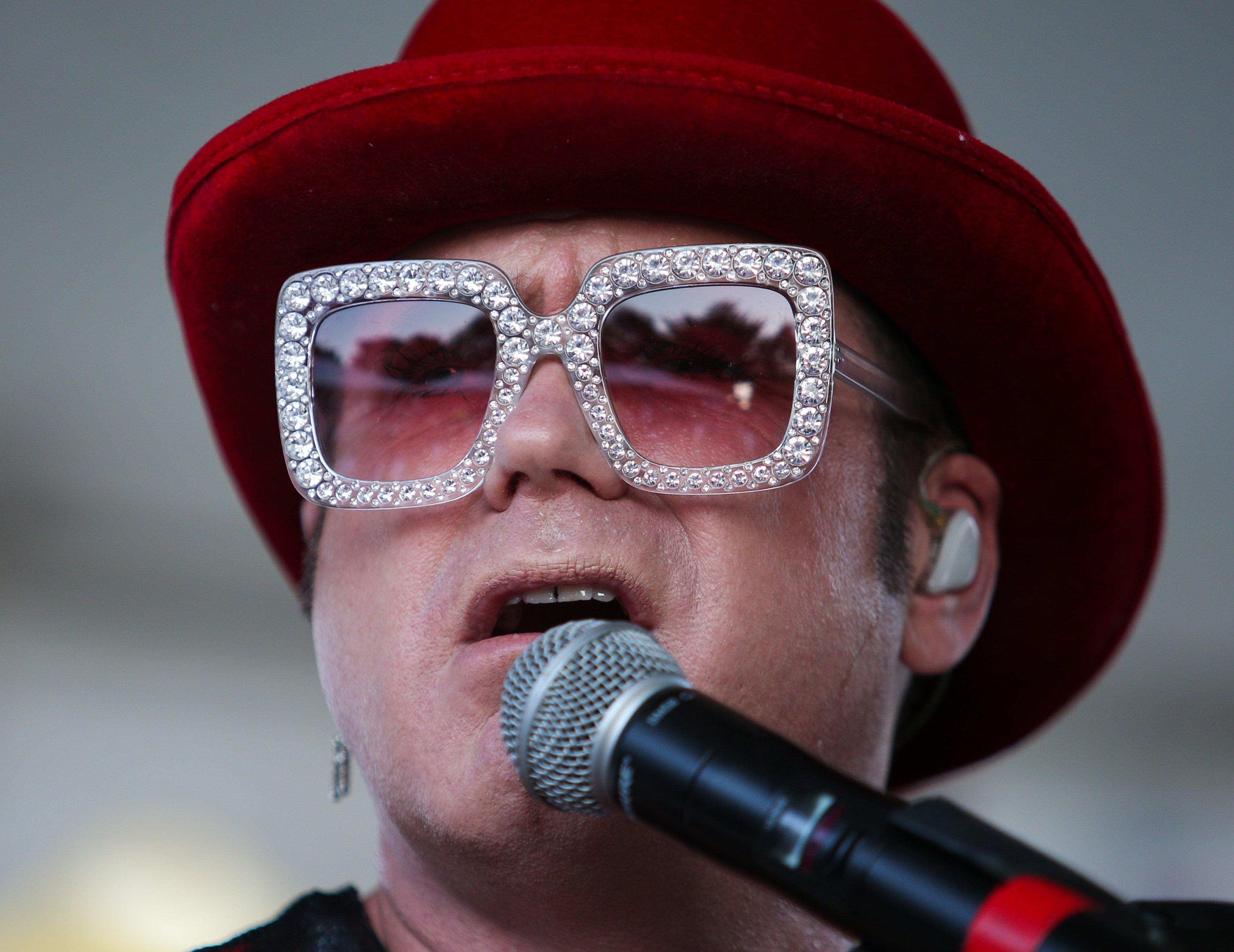 Elton John tribute artist performs