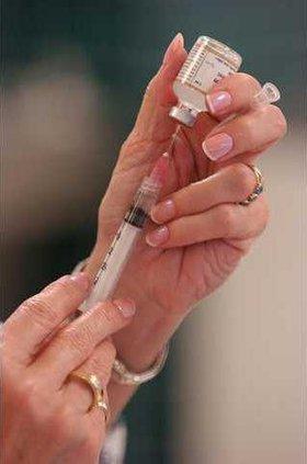 Vaccination syringe